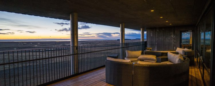 Secluded Patio with heaters, fire pits, and views of the Arctic Sunset